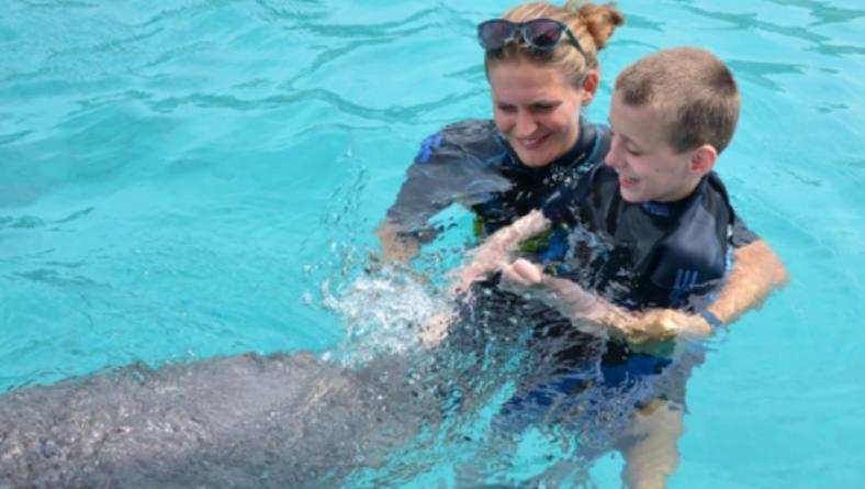 Sven en dolfijn Nubia